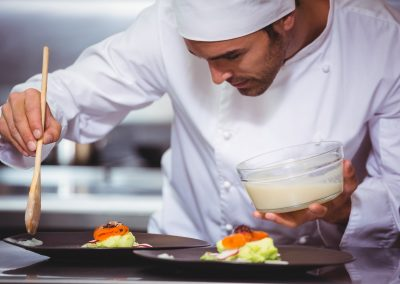 Chef putting sauce on a dish